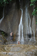 Cooling off under one of Kanchanaburi's many waterfalls